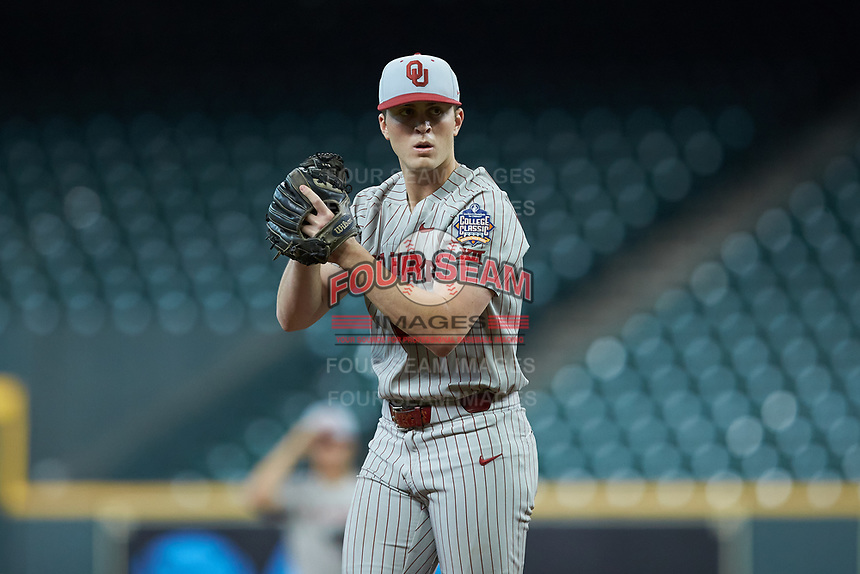 Oklahoma Sooners starting pitcher Dane Acker (28) looks to his catcher for the sign against the LSU Tigers in game seven of the 2020 Shriners Hospitals for Children College Classic at Minute Maid Park on March 1, 2020 in Houston, Texas. The Sooners defeated the Tigers 1-0. (Brian Westerholt/Four Seam Images)