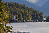 Kayakers paddle in Sitka Channel, near the Rockwell Lighthouse, southeast, Alaska.