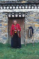 Tagong - Tibetan woman in doorway.