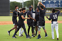 FCL Yankees Madison Santos (34) celebrates with teammates after hitting a walk-off double during a game against the FCL Phillies on July 6, 2021 at the Yankees Minor League Complex in Tampa, Florida.  (Mike Janes/Four Seam Images)
