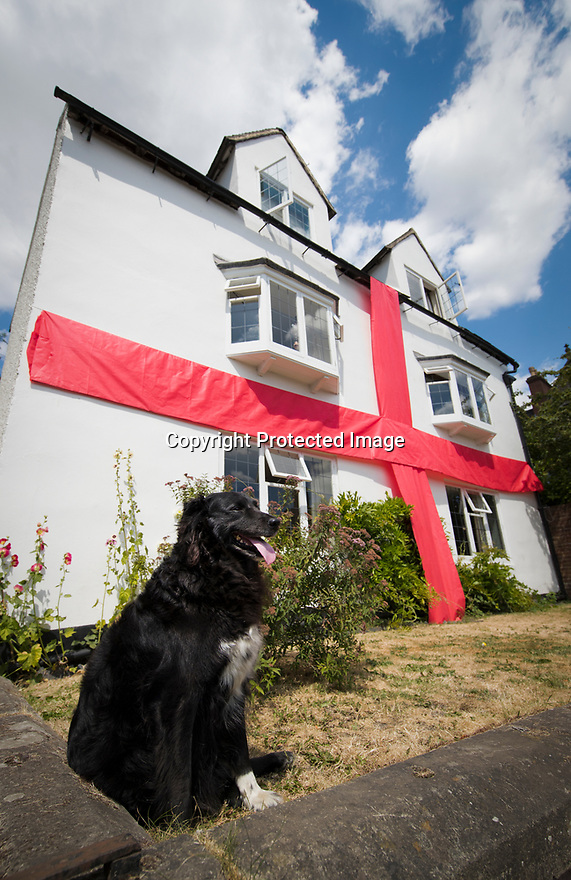 """***CAPTION CORRECTION***<br /> <br /> 08/07/18<br /> <br /> As more of the country gets behind the English team, Robin Cantellow (54) adorns his four bedroomed 17th century house with a ten by five metre giant ribbon in Ashbourne, Derbyshire.<br /> <br /> """"I put it up yesterday before the match and that worked, so I'm keeping it up for another week - hopefully""""<br /> All Rights Reserved, F Stop Press Ltd. (0)1335 344240 +44 (0)7765 242650  www.fstoppress.com rod@fstoppress.com"""