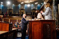 WASHINGTON, DC - APRIL 28: President Joe Biden hands his speech to Vice President Harris and House Speaker Nancy Pelosi (D-Calif.) before he addresses a joint session of Congress, with Vice President Kamala Harris and House Speaker Nancy Pelosi (D-Calif.) on the dais behind him, on Wednesday, April 28, 2021. Biden spoke to a nation seeking to emerge from twin crises of pandemic and economic slide in his first speech to a joint session of Congress. <br /> CAP/MPI/RS<br /> ©RS/MPI/Capital Pictures