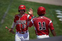Batavia Muckdogs second baseman Taylor Munden (21) high fives Stone Garrett (11) after scoring a run during a game against the State College Spikes August 23, 2015 at Dwyer Stadium in Batavia, New York.  State College defeated Batavia 8-2.  (Mike Janes/Four Seam Images)