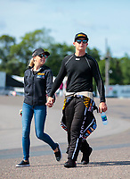 Aug 18, 2019; Brainerd, MN, USA; NHRA top fuel driver Austin Prock with girlfriend Joanne Dunn during the Lucas Oil Nationals at Brainerd International Raceway. Mandatory Credit: Mark J. Rebilas-USA TODAY Sports
