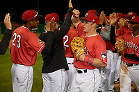 Batavia Muckdogs Peyton Burdick (7) celebrates with teammates, including Andres Sthormes (black) and Brayan Hernandez (23), after a NY-Penn League game against the Auburn Doubledays on June 14, 2019 at Dwyer Stadium in Batavia, New York.  Batavia defeated 2-0.  (Mike Janes/Four Seam Images)
