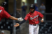 Billings Mustangs Reniel Ozuna (23) is congratulated after scoring a run during a Pioneer League game against the Grand Junction Rockies at Dehler Park on August 15, 2019 in Billings, Montana. Billings defeated Grand Junction 11-2. (Zachary Lucy/Four Seam Images)