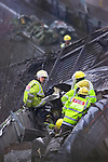 Pix: Shaun Flannery/www.shaunflanneryphotography.com..COPYRIGHT PICTURE>>SHAUN FLANNERY>01302-570814>>07778315553>>..28th February 2001.........Fire & Rescue personell check the wreakage after the rail crash at Great Heck nr. Selby. Ten people were killed after a Land Rover driven by Gary Hart crashed on to the East Coast Mainline de-railing a goods and high speed train.