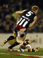 Adelaide Crows v Collingwood at Telstra Dome  15/8/03  Nathan Buckley loses his pants to Mark Bickley. - pic by Trevor Collens