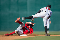 Mickey Moniak (22) of the Lakewood BlueClaws steals second base ahead of the tag attempt by Mitch Roman (10) of the Kannapolis Intimidators at Kannapolis Intimidators Stadium on April 9, 2017 in Kannapolis, North Carolina.  The BlueClaws defeated the Intimidators 7-1.  (Brian Westerholt/Four Seam Images)