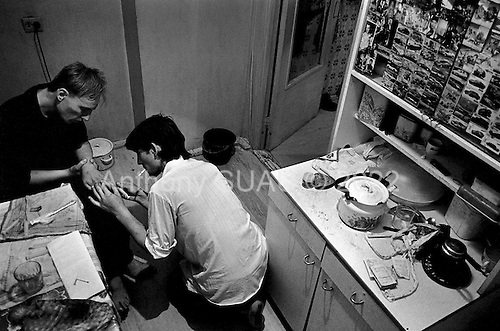Osh, Krygystan.1996.Two opium junkies shoot up in their apartment. Osh has become the center of Afghan produced opium as it arrives in Kyrgyzstan via Tajikistan on the old silk road. Most of the opium is destined for Western Europe.