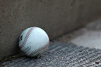 A baseball sits on the dugout step during a game between the Buffalo Bisons and Syracuse Chiefs at Dunn Tire Park on April 7, 2011 in Buffalo, New York.  Syracuse defeated Buffalo 8-5.  Photo By Mike Janes/Four Seam Images