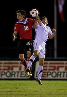 Zachary Carroll (17) of the United States goes up for a header with Jay Chapman (16) of Canada during the finals of the CONCACAF Men's Under 17 Championship at Catherine Hall Stadium in Montego Bay, Jamaica. The United States defeated Canada, 3-0, in overtime