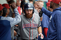 Lehigh Valley IronPigs left fielder Andrew Pullin (15) celebrates with teammates in the dugout after hitting a home run in the top of the seventh inning during a game against the Syracuse Chiefs on May 20, 2018 at NBT Bank Stadium in Syracuse, New York.  Lehigh Valley defeated Syracuse 5-2.  (Mike Janes/Four Seam Images)