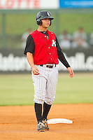 Joey DeMichele (17) of the Kannapolis Intimidators takes his lead off of second base against the Rome Braves at CMC-Northeast Stadium on August 5, 2012 in Kannapolis, North Carolina.  The Intimidators defeated the Braves 9-1.  (Brian Westerholt/Four Seam Images)