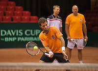 10-09-13,Netherlands, Groningen,  Martini Plaza, Tennis, DavisCup Netherlands-Austria, Training, Jean-Julien Rojer  (NED) in the background captain Jan Siemerink(M) and coach Raymond Knaap<br /> Photo: Henk Koster