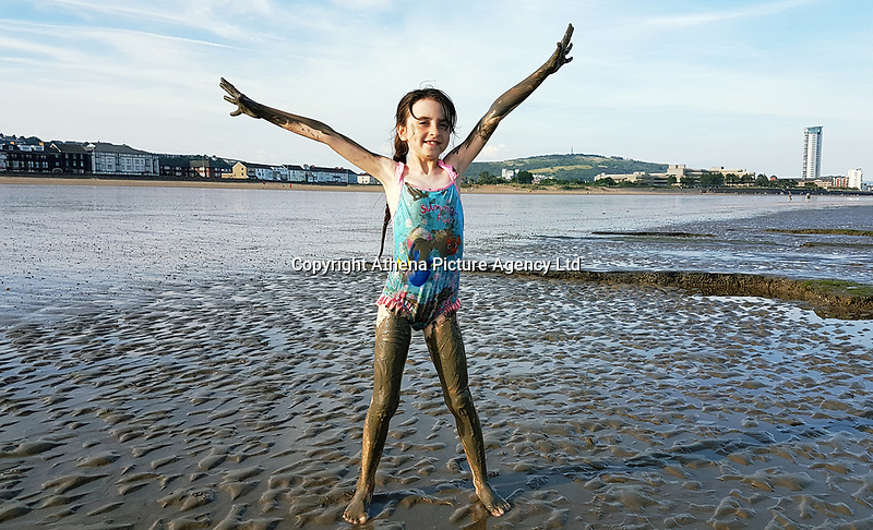 WEATHER PICTURE WALES<br /> Pictured: Eight year old Sophie Rhian plays on the sandy beach of Swansea Bay, Wales, UK.<br /> Re: High temperatures and sunshine in most parts of the UK.