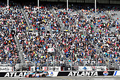 2017 NASCAR XFINITY Series - Rinnai 250<br /> Atlanta Motor Speedway, Hampton, GA USA<br /> Saturday 4 March 2017<br /> Kyle Busch, NOS Energy Drink Toyota Camry takes the checkered flag and the win<br /> World Copyright: Nigel Kinrade/LAT Images<br /> ref: Digital Image 17ATL1nk05761