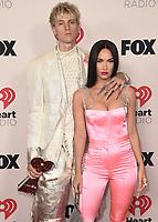 2021 IHEART RADIO MUSIC AWARDS:  Machine Gun Kelly and Megan Fox at the 2021 IHEARTRADIO MUSIC AWARDS airing live May 27 (8:00-10:00 PM ET / PT tape-delayed) on FOX . (Photo by Scott Kirkland/FOX/PictureGroup). © 2021 FOX MEDIA , LLC.