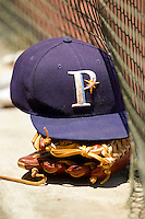 A Princeton Rays hat sits on top of a glove during the Appalachian League game against the Burlington Royals at Hunnicutt Field on July 15, 2012 in Princeton, West Virginia.  The Royals defeated the Rays 2-0 in game one of a double header.  (Brian Westerholt/Four Seam Images)