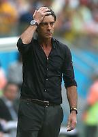 A soaking wet Germany coach Joachim Loew on the touchline