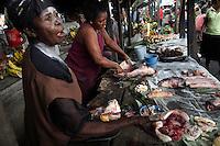 Women sell fish caught at Wagenia Falls in Kisangani market.