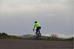 Man riding bike in Red Rocks State Park, Colorado