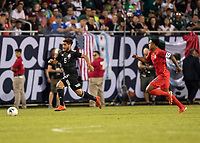 CHICAGO, IL - JULY 7: Jonathan Dos Santos #6 makes a run with Weston Mckennie #8 in pursuit during a game between Mexico and USMNT at Soldiers Field on July 7, 2019 in Chicago, Illinois.