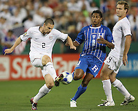 Heath Pearce #2 of the USA boots the ball away from Carlos Costly #13 of Honduras during a CONCACAF Gold Cup match at RFK Stadium on July 8 2009 in Washington D.C.