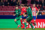 Antoine Griezmann (C) of Atletico de Madrid battles for the ball with Maciej Rybus (L) and Vedran Corluka of FC Lokomotiv Moscow during the UEFA Europa League 2017-18 Round of 16 (1st leg) match between Atletico de Madrid and FC Lokomotiv Moscow at Wanda Metropolitano  on March 08 2018 in Madrid, Spain. Photo by Diego Souto / Power Sport Images