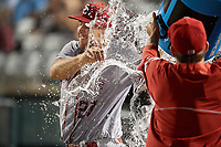 Syracuse Chiefs starting pitcher Traylor Hill (27) is doused with water after allowing three hits over eight innings during a game against the Buffalo Bisons on June 30, 2017 at Coca-Cola Field in Buffalo, New York.  Syracuse defeated Buffalo 8-1.  (Mike Janes/Four Seam Images)