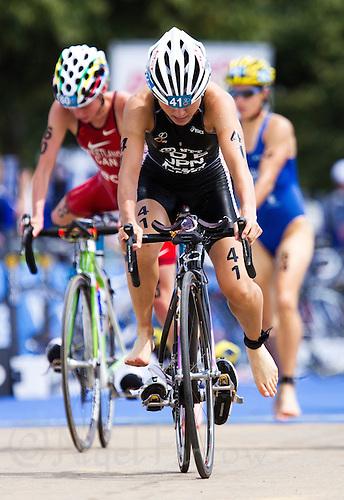 24 JUL 2010 - LONDON, GBR - Juri Ide mounts her bike as she leaves transition during the womens race of the London round of the ITU World Championship Series triathlon (PHOTO (C) NIGEL FARROW)