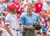 30 August 2015: MLB Umpire Dale Scott chats with a bat boy during a game between the Miami Marlins and the Washington Nationals at Nationals Park in Washington, DC. The Nationals rallied to defeat the Marlins 7-4 in the third game of their 3-game weekend series. Mandatory Credit: Ed Wolfstein Photo *** RAW (NEF) Image File Available ***