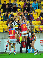 Players leap for the ball during the ANZAC Day AFL match between St Kilda Saints and Brisbane Lions at Westpac Stadium, Wellington, New Zealand on Friday, 25 April 2014. Photo: Dave Lintott / lintottphoto.co.nz
