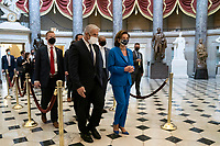 Speaker of the United States House of Representatives Nancy Pelosi (Democrat of California) and Yair Lapid, Alternate Prime Minister and Minister of Foreign Affairs of the State of Israel, walk through Statuary Hall at the US Capitol in Washington, DC., Tuesday, October 12, 2020.<br /> Credit: Sarah Silbiger / CNP /MediaPunch