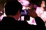 A man takes a picture of the illuminations at Shinjuku Terrace City on November 16, 2017, Tokyo, Japan. Shinjuku Terrace City Illuminations are seen around Odakyu Line Shinjuku Station. This year marks the 12th year of the illumination event, which can be enjoyed until February 22, 2018. (Photo by Rodrigo Reyes Marin/AFLO)