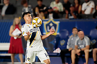 CARSON, CA - SEPTEMBER 15: Joe Corona #14 of the Los Angeles Galaxy traps a ball during a game between Sporting Kansas City and Los Angeles Galaxy at Dignity Health Sports Complex on September 15, 2019 in Carson, California.