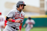 Roberto Lopez (20) of the Arkansas Travelers rounds third base during a game against the Springfield Cardinals on May 10, 2011 at Hammons Field in Springfield, Missouri.  Photo By David Welker/Four Seam Images.