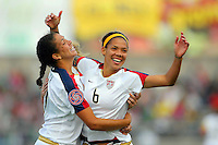 Action photo of Natasha Kai of United States celebrating goal against Costa Rica, during game of the Womens Preolympic soccer tournament held at Ciudad Juarez. Mexico