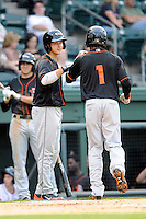 Outfielder Gregory Lorenzo (1) of the Delmarva Shorebirds is congratulated after scoring a run in a game against the Greenville Drive on Friday, April 26, 2013, at Fluor Field at the West End in Greenville, South Carolina. Lorenzo is listed as the No. 29 prospect of the Baltimore Orioles, according to Baseball America. Delmarva won, 10-3. (Tom Priddy/Four Seam Images)