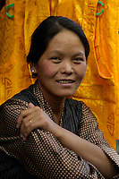 A young Women from Tibet in Lhasa a shopkeeper, near Barkhor street, Tibet