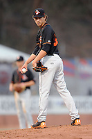 Delmarva Shorebirds starting pitcher Hunter Harvey #35 checks the runner at first during a game against the Asheville Tourists at McCormick Field on April 4, 2014 in Asheville, North Carolina. The Shorebirds defeated the Tourists 7-2. (Tony Farlow/Four Seam Images)