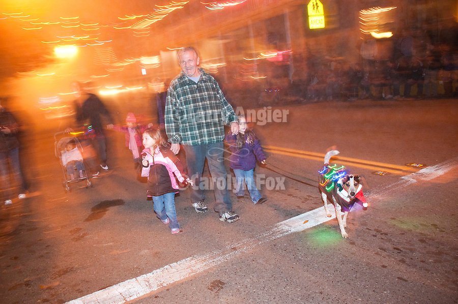 Sutter Creek, California's Parade of Lights, downtown on Main Street on a foggy winter's eve.