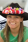 Kari Millhouse wears a colorful flower garland on her cowboy hat at the Jordan Valley Big Loop Rodeo
