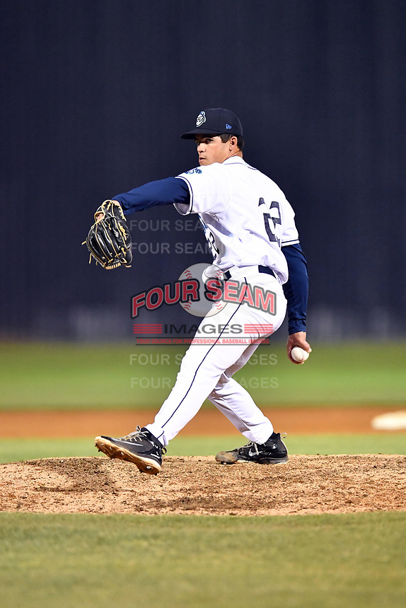 Asheville Tourists pitcher Boby Johnson (22) delivers a pitch during a game against the Charleston RiverDogs at McCormick Field on April 10, 2019 in Asheville, North Carolina. The  RiverDogs defeated the Tourists 5-3. (Tony Farlow/Four Seam Images)
