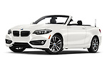 Stock pictures of low aggressive front three quarter view of a 2019 BMW 2 Series 230i Sport Line 2 Door Convertible