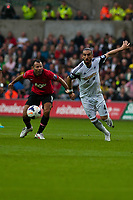 Saturday 17 August 2013<br /> <br /> Pictured: Ryan Giggs of Manchester United and Chico Flores of Swansea<br /> <br /> Re: Barclays Premier League Swansea City v Manchester United at the Liberty Stadium, Swansea, Wales