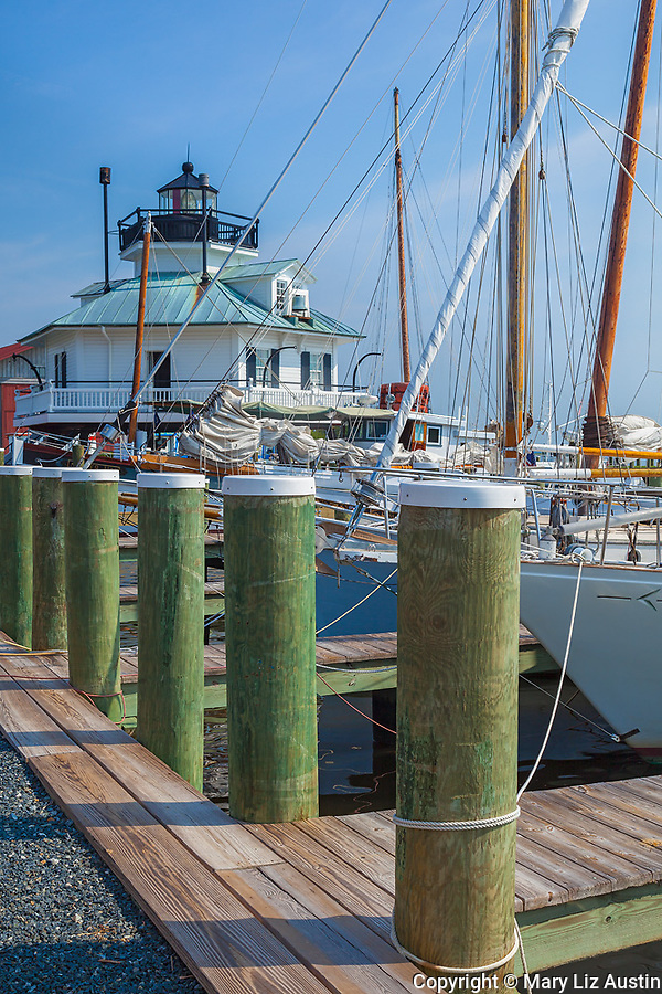 Chesapeake Bay Maritime Museum, St. Michaels, Maryland<br /> Dock pilings and Hooper Strait Lighthouse (1879) at  Navy Point