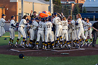 Michigan Wolverines celebration after Jimmy Obertop's walk off home run against the Michigan State Spartans on March 21, 2021 in NCAA baseball action at Ray Fisher Stadium in Ann Arbor, Michigan. Michigan scored 8 runs in the bottom of the ninth inning to defeat the Spartans 8-7. (Andrew Woolley/Four Seam Images)