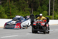 May 17, 2015; Commerce, GA, USA; A member of the Safety Safari drives a quad alongside NHRA funny car driver Tim Wilkerson who is slowing down after winning the Southern Nationals at Atlanta Dragway. Mandatory Credit: Mark J. Rebilas-USA TODAY Sports