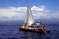 Hawaiian sailing canoe Eala, sister to the Hokulea, with crew off the coast of the Big Island near Ka lae and Milolii